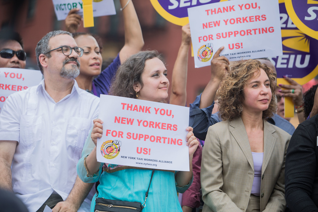 Bhairavi Desai (center), executive director of the New York Taxi Workers Alliance.