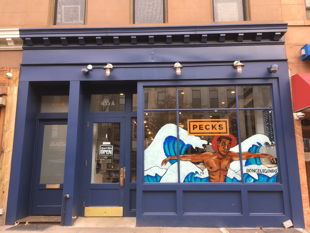 A Black Artstory month mural by Steven Mosley decorates the window of Peck's on Myrtle Avenue.
