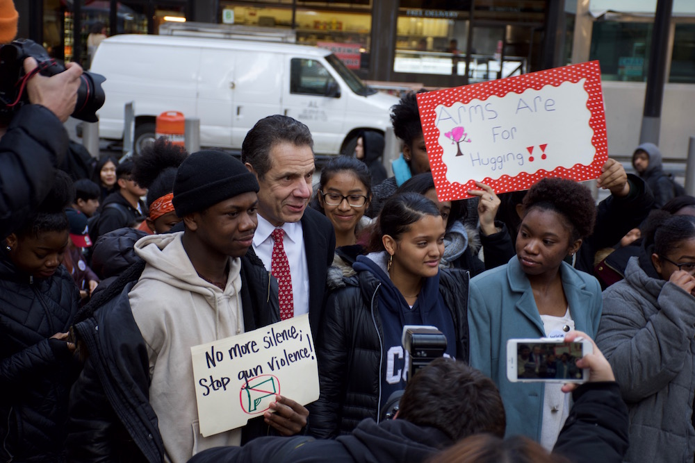 Gov. Andrew Cuomo stands with students as they rallied for gun control in Lower Manhattan.