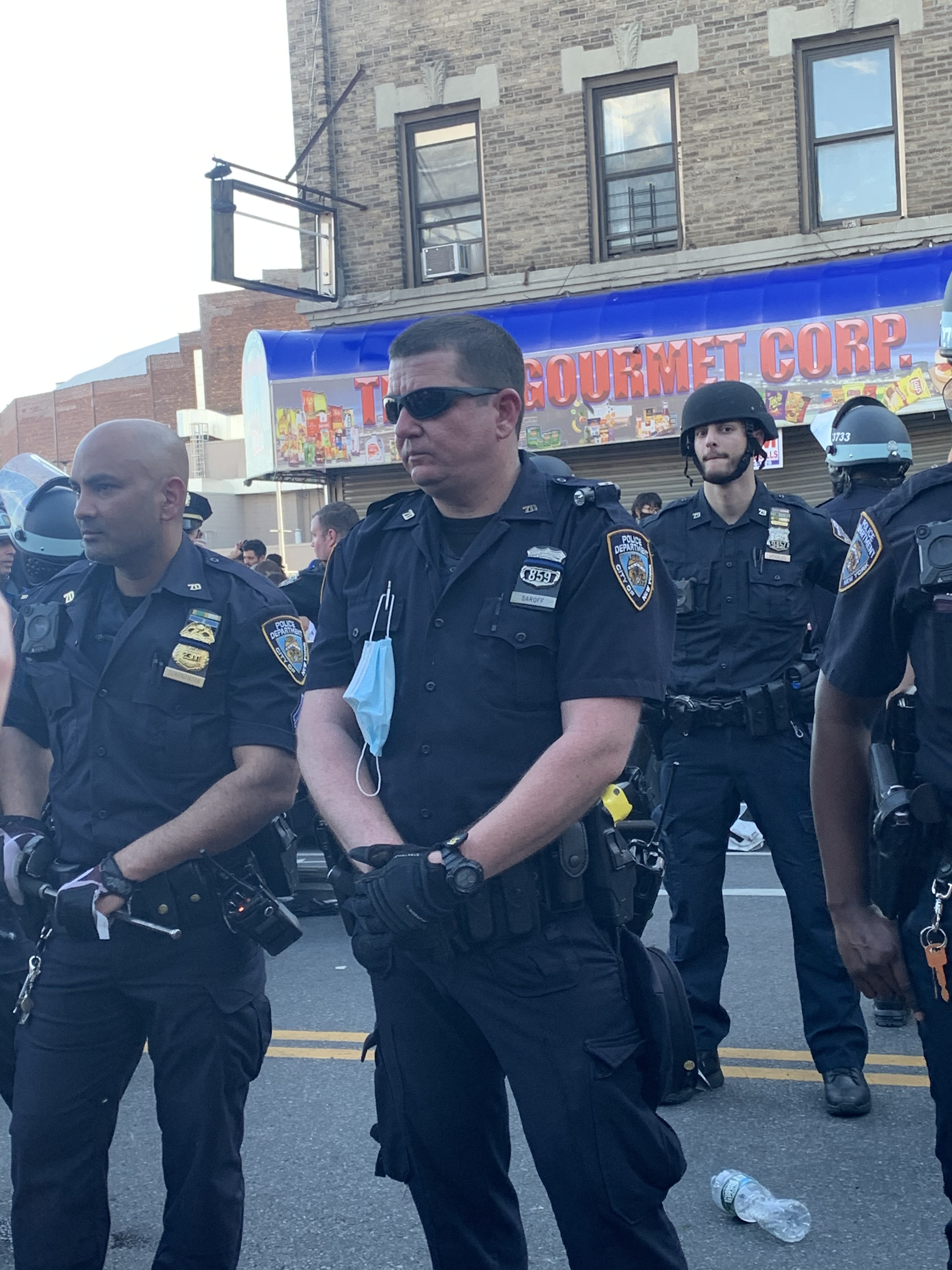 Maskless NYPD officers at a protest in Flatbush on Saturday.