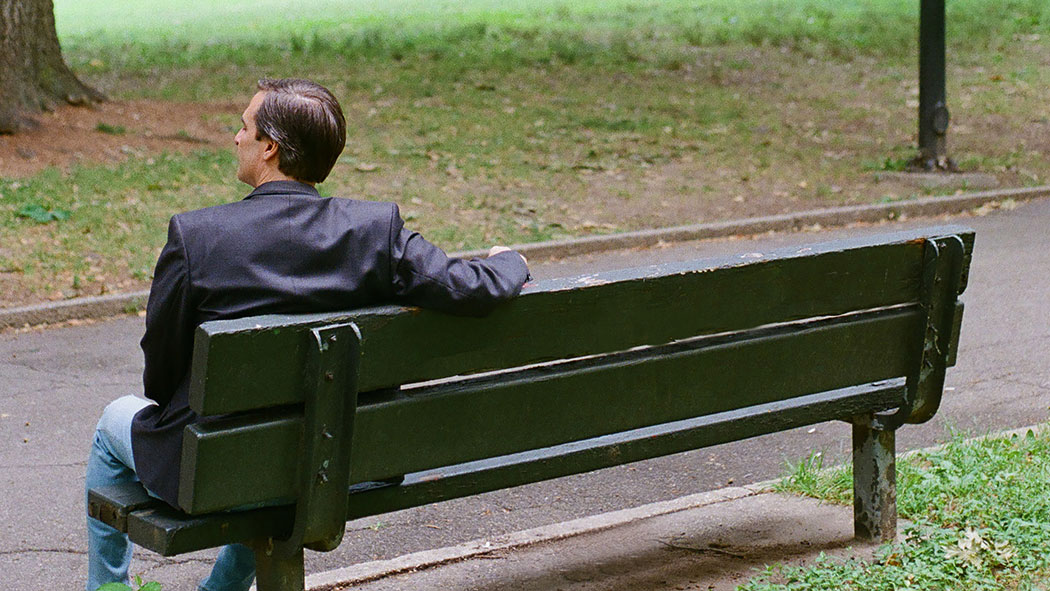 Gianaris sits on a park bench in Queens.