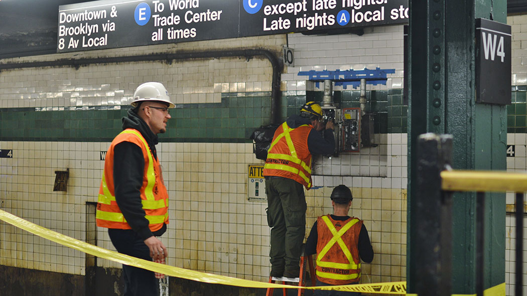 MTA employees at work.