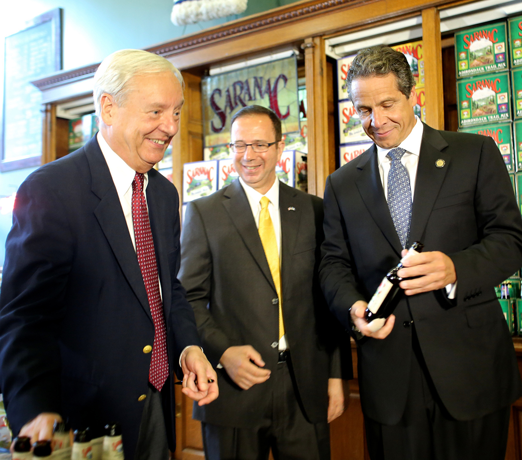 Andrew Cuomo looking at a beer
