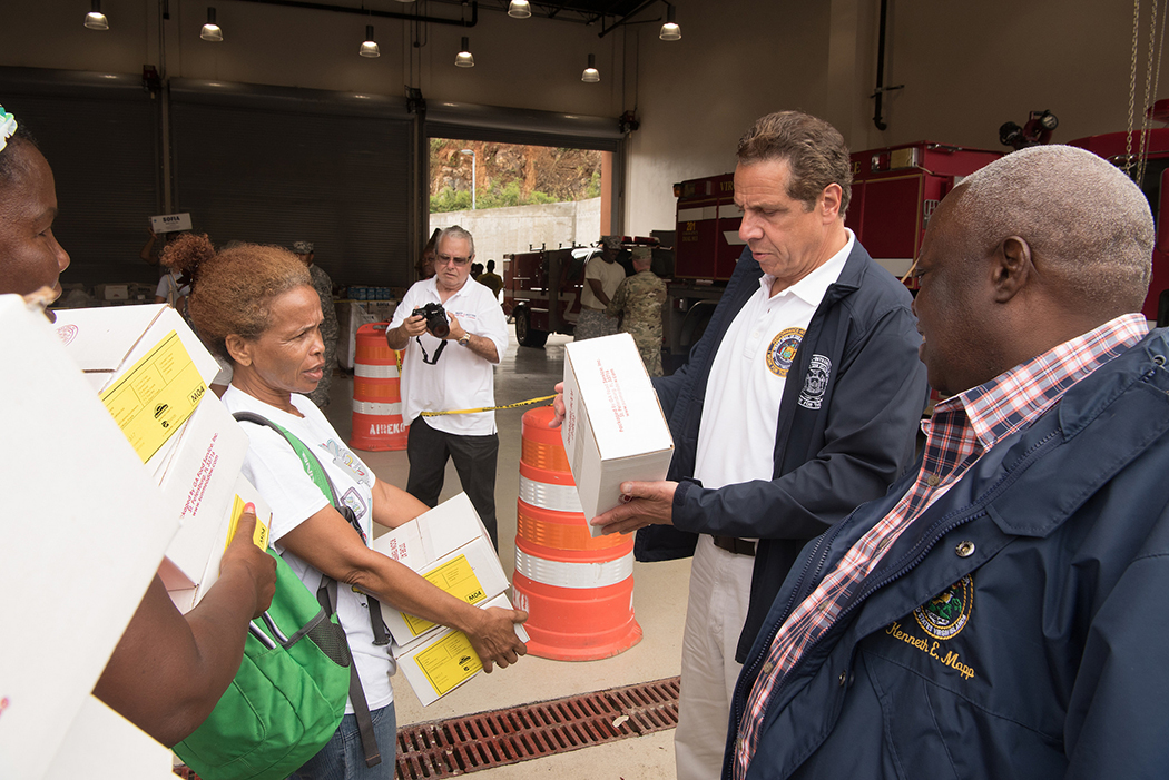 Andrew Cuomo looking at a box