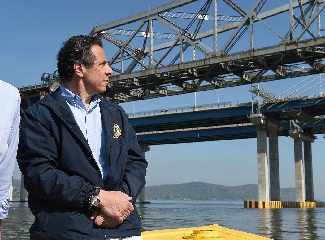 Andrew Cuomo looking at a bridge