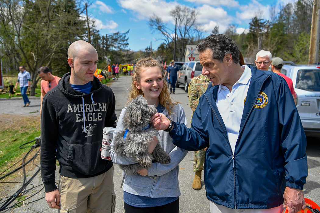 Andrew Cuomo looking at a dog