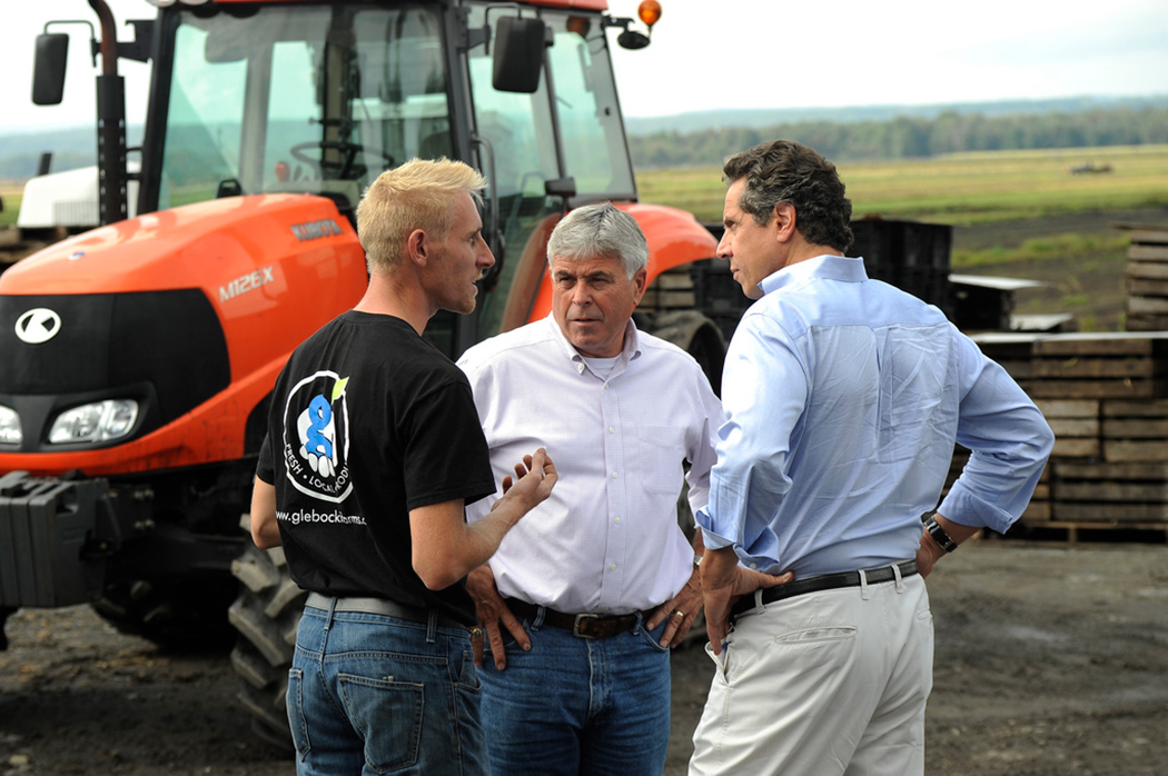 Andrew Cuomo looking at farmers
