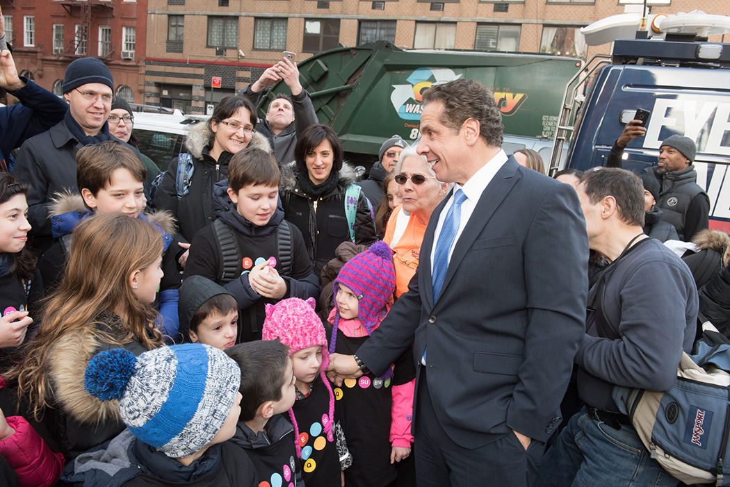 Andrew Cuomo looking at children