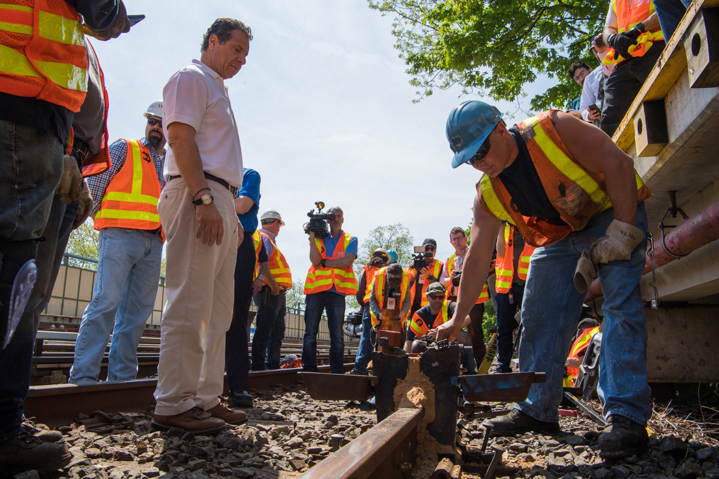 Andrew Cuomo looking at train tracks