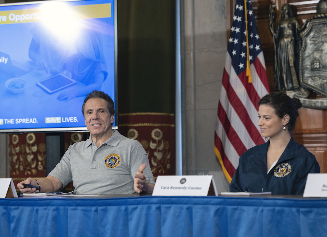 Cara Cuomo next to her father at a coronavirus press conference.