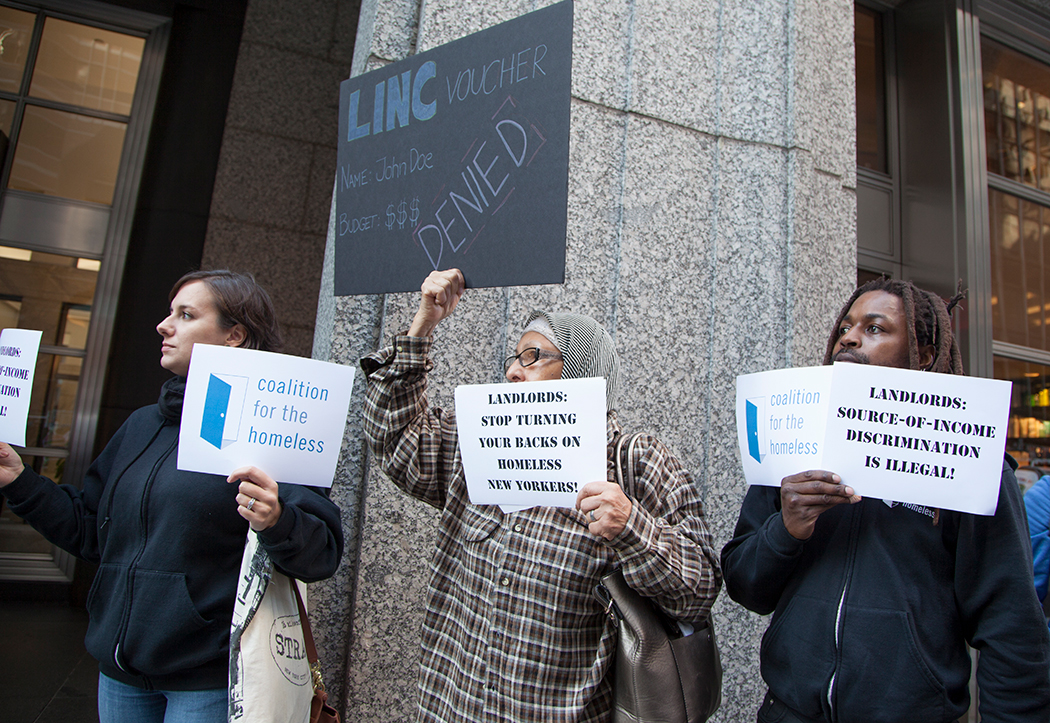 Coalition for the Homeless staff and advocates protest source of income discrimination outside a realty office in November, 2016.