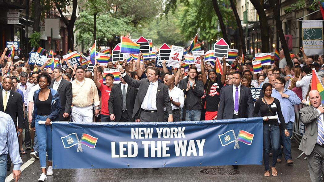 Gov. Andrew Cuomo smiles and waves in the 2015 New York City Pride.