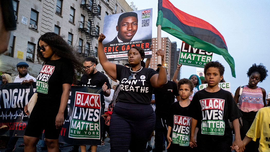 Black Lives Matter activists protest in Harlem, in the wake of a decision by federal prosecutors who declined to bring civil rights charges against NYPD officer Daniel Pantaleo.