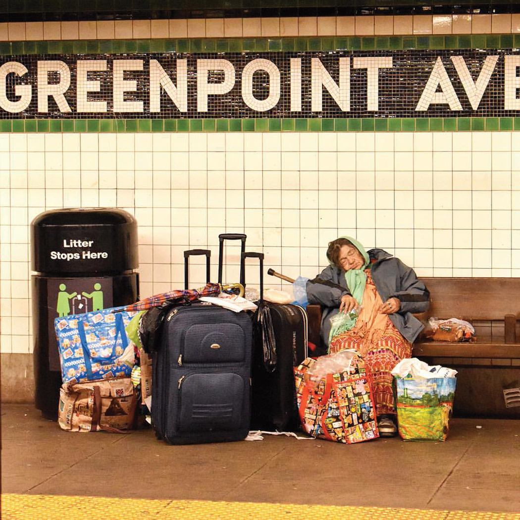 A homeless woman at the Greenpoint Ave. G train station in Brooklyn.