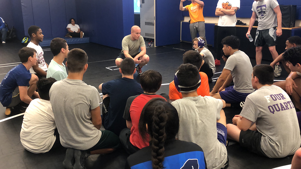 Max Rose talks to a bunch of wrestlers