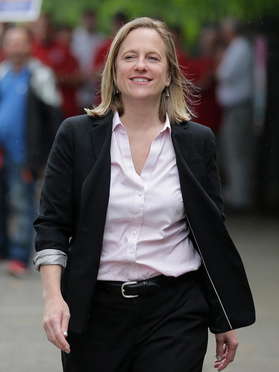 Melinda Katz walking down the street smiling