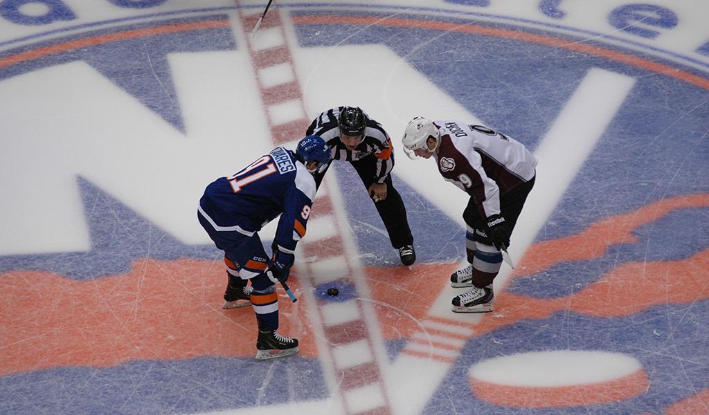 New York Islanders' John Tavares faces off against Matt Duchene of the Colorado Avalanche at the old Nassau Veterans Memorial Coliseum.