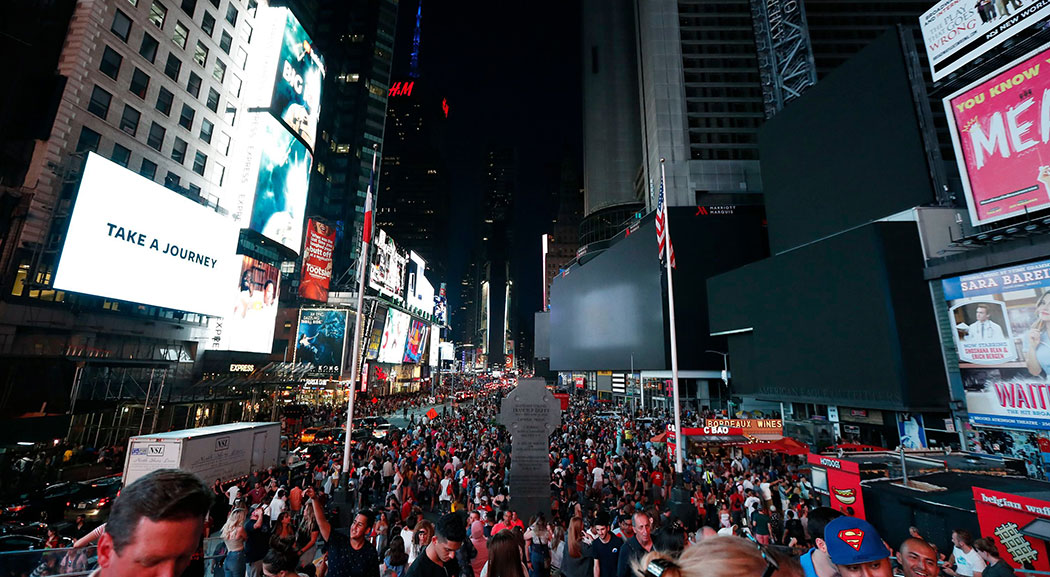 Screens in Times Square went black during a power outage in New York City on Saturday.