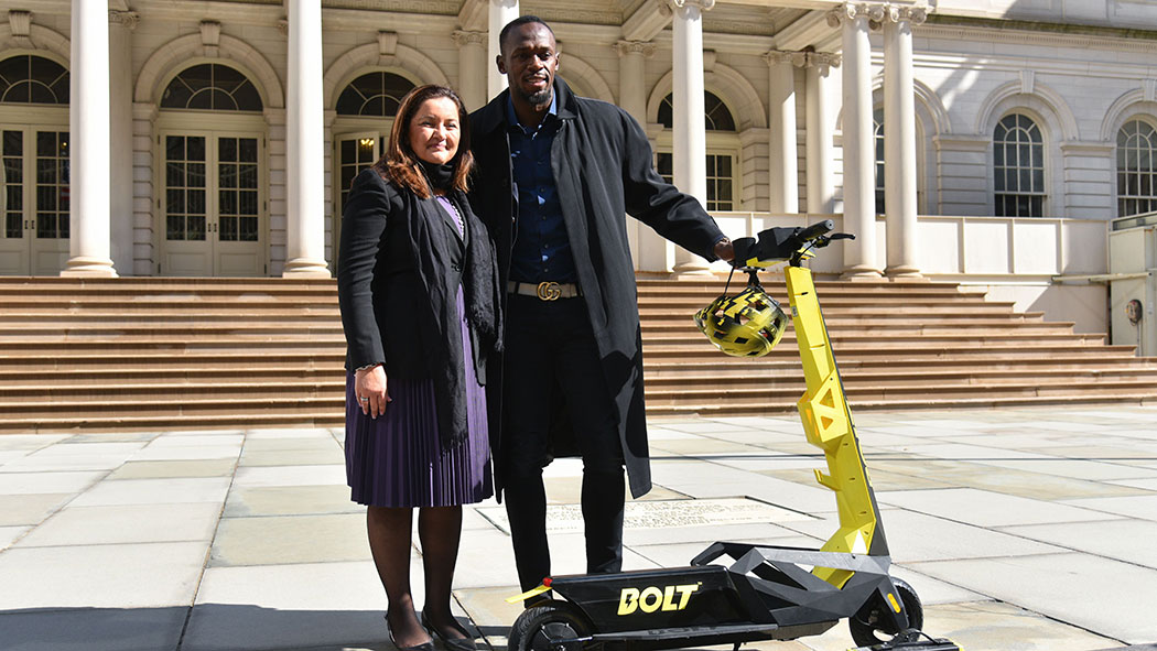 Dr. Sarah Haynes, Chairwoman and Co-founder of Bolt Mobility and Usain Bolt unveiling Bolt Personal Electric Scooters on the steps of New York City Hall in March.